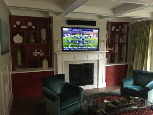 tv and speaker bar over fireplace