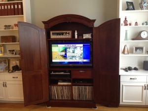 tv in closed cabinet