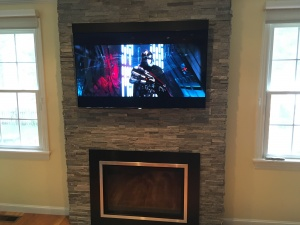 tv on stone fireplace