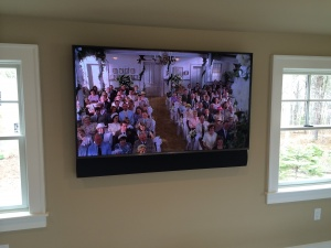 tv with custom length triad speaker bar