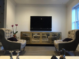 tv with custom triad speaker bar