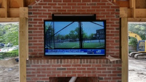SunBrite Veranda Series Outdoor TV over Fireplace with Sonos PlayBar