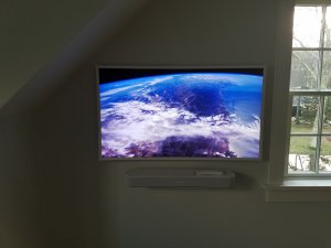 Samsung Frame TV in Bedroom with Sonos Beam