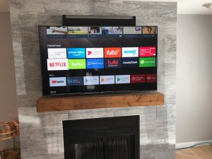 Sony TV on Tile over Fireplace with Sonos PlayBar