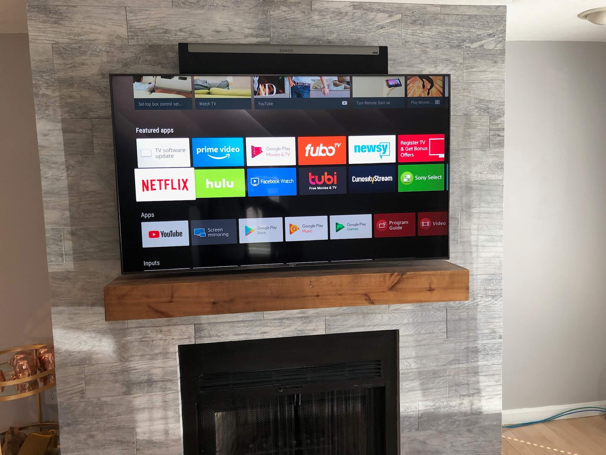 Sony TV on Tile over Fireplace with Sonos PlayBar – South